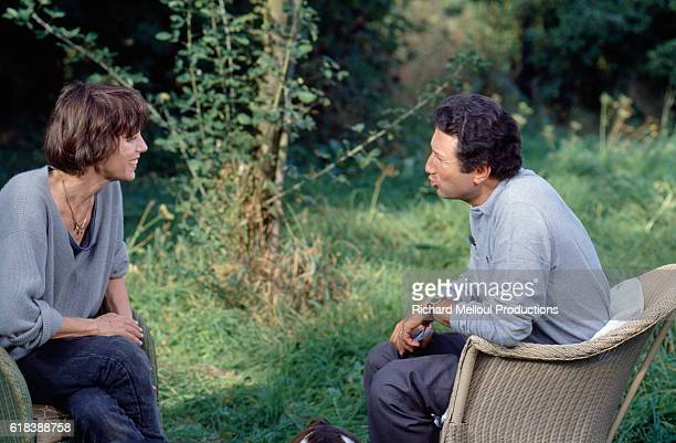 Actress Jane Birkin talks with French television host Michel Drucker outside her Normandy home