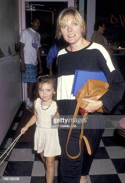 Actress Jane Curtin and daughter Tess Lynch on September 11 1987 arriving at Lacy's Surferteria in New York City New York