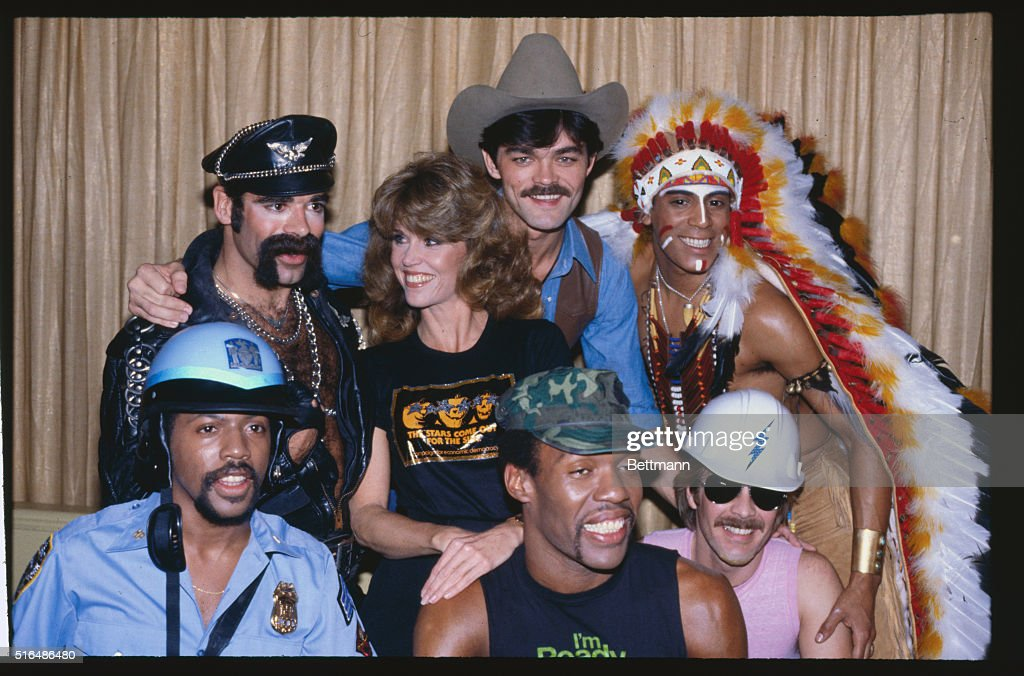 Jane Fonda Posing with Village People : News Photo