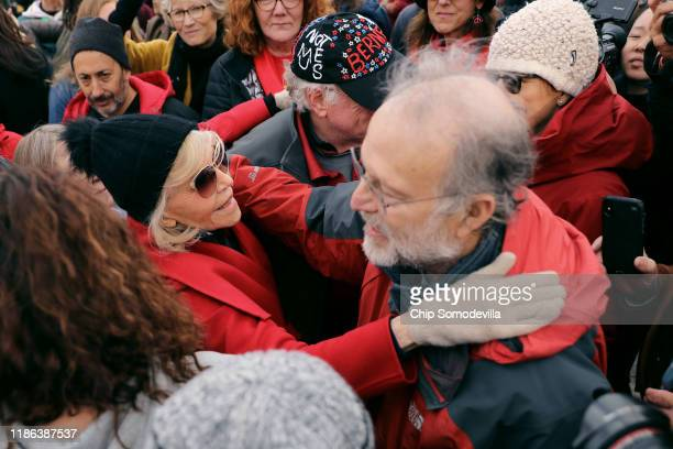 Actress Jane Fonda embraces Jerry Greenfield of Ben and Jerry's ice cream maker at the conclusion of her Fire Drill Fridays rally protesting against...