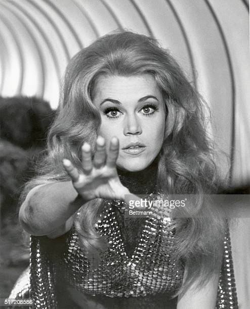 Actress Jane Fonda in a closeup with her arm outstretched in the 1968 production of Barbarella Undated movie still