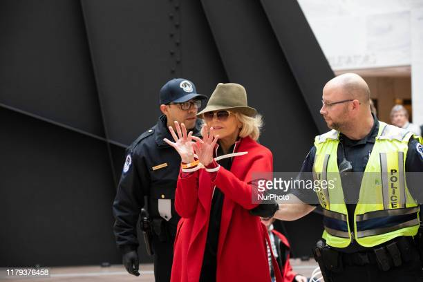Actress Jane Fonda is arrested by US Capitol Police officers during a ''Fire Drill Fridays'' climate change protest inside the Hart Senate Office...