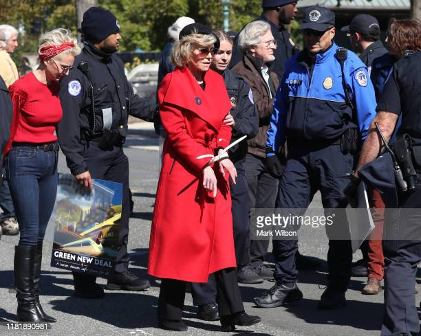 "Actress Jane Fonda is arrested for blocking a street in front of the US Capitol during a ""Fire Drill Fridays"" climate change protest and rally on..."