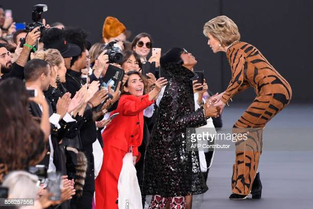 TOPSHOT US actress Jane Fonda kisses British model Naomi Campbell during the L'Oreal fashion which theme is Paris on the sidelines of the Paris...