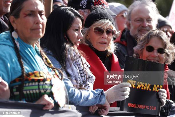 Actress Jane Fonda leads hundreds of people in a march from the US Capitol to the White House as part of her Fire Drill Fridays rally protesting...