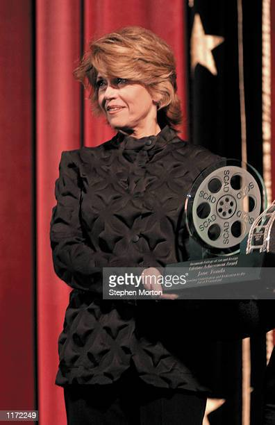 Actress Jane Fonda receives the Savannah College of Art and Design's Lifetime Achievement Award in Film October 29 2001 from SCAD President Paula...