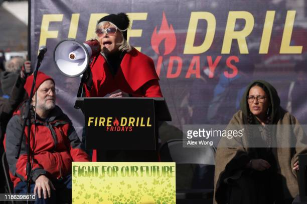 Actress Jane Fonda speaks during a rally prior to a march from the US Capitol to the White House as part of her Fire Drill Fridays rally protesting...