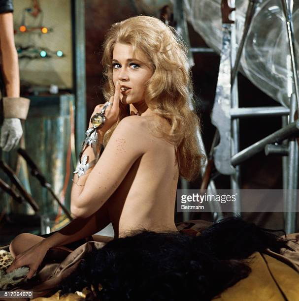 Actress Jane Fonda stripping during a scene from the 1967 movie Barbarella