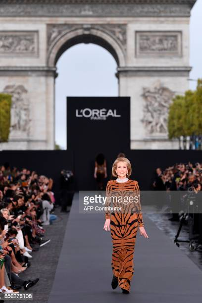 Actress Jane Fonda takes part in the L'Oreal fashion show on the sidelines of the Paris Fashion Week on October 1 on a catwalk set up on the...