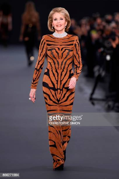 US actress Jane Fonda takes part in the L'Oreal fashion which theme is Paris on the sidelines of the Paris Fashion Week on October 1 on a catwalk set...