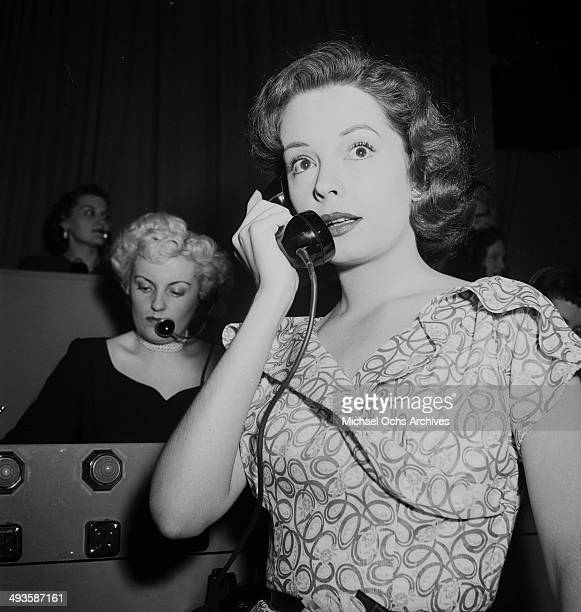 Actress Jane Greer on the phone during a telethon in Los Angeles California