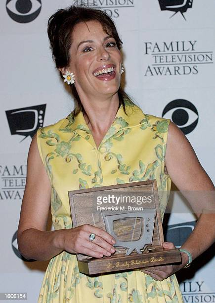 Actress Jane Kaczmarek of the television show 'Malcolm in the Middle' holds her best actress award during taping of the Third Annual Family Awards...