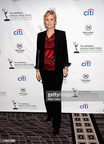 Actress Jane Lynch arrives at the Academy of Television Arts Sciences' Performers Peer Group cocktail reception to celebrate the 65th Primetime Emmy...