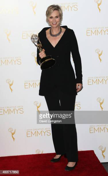 Actress Jane Lynch attends the 2014 Creative Arts Emmy Awards press room at the Nokia Theatre LA Live on August 16 2014 in Los Angeles California