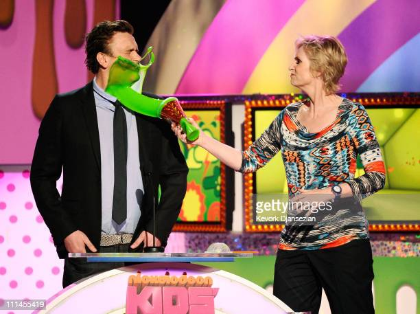 Actress Jane Lynch slimes actor Jason Segel onstage during Nickelodeon's 24th Annual Kids' Choice Awards at Galen Center on April 2 2011 in Los...