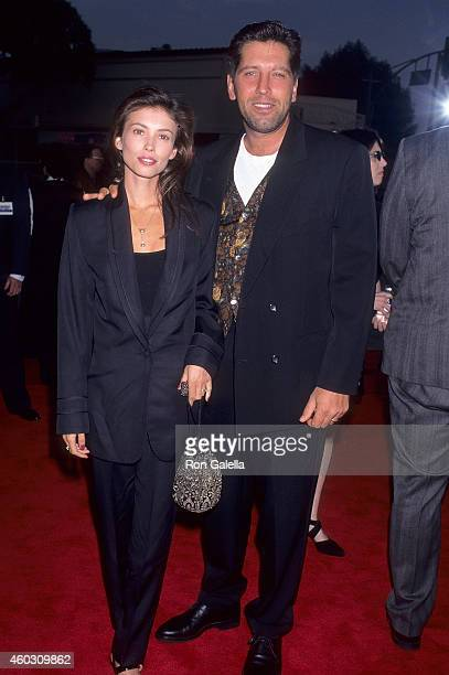 Actress Jane Marchand husband actor Carmine Zozzora attend the Die Hard With a Vengeance Westwood Premiere on May 18 1995 at the Mann Village Theatre...