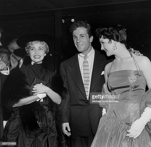Actress Jane Powell poses with Steve Rowland and Kathleen Case as they attend the Cantors party for Debbie Reynolds and Eddie Fisher in Los AngelesCA
