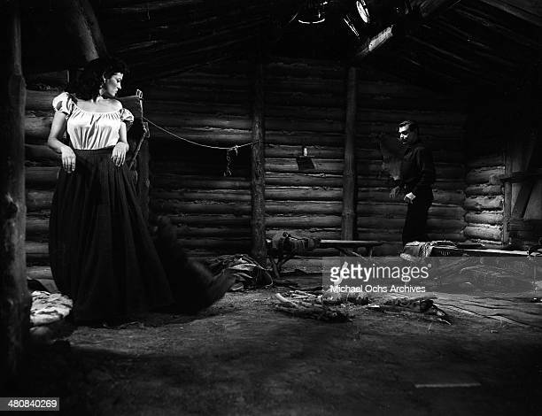 Actress Jane Russell and actor Clark Gable in a scene from the 20th Century Fox movie 'The Tall Men' circa 1955