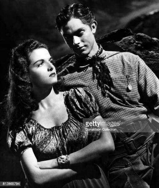 """Actress Jane Russell and actor Jack Buetel in a portrait session for the movie """"The Outlaw"""" which was released on February 5, 1943."""