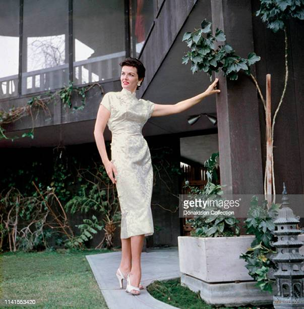 Actress Jane Russell at home in an evening gown in 1957.