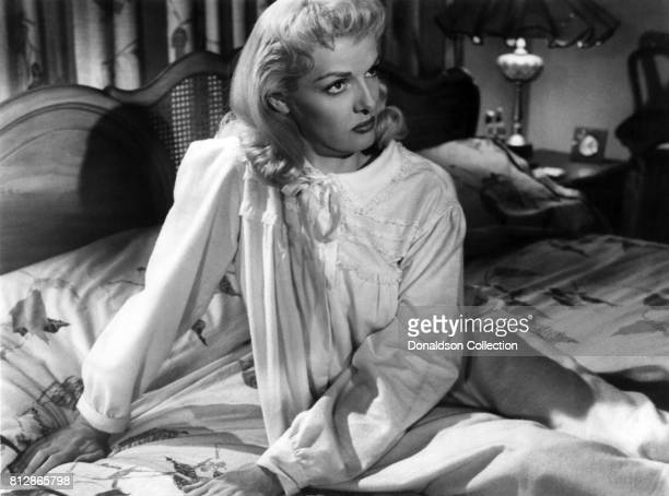 """Actress Jane Russell in a scene from the movie """"the Fuzzy Pink Nightgown"""" which was released August 23, 1957."""