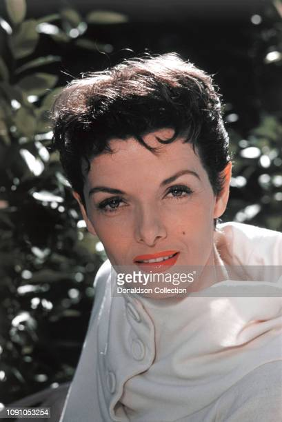 Actress Jane Russell poses for a photo at home in 1957 in Los Angeles California