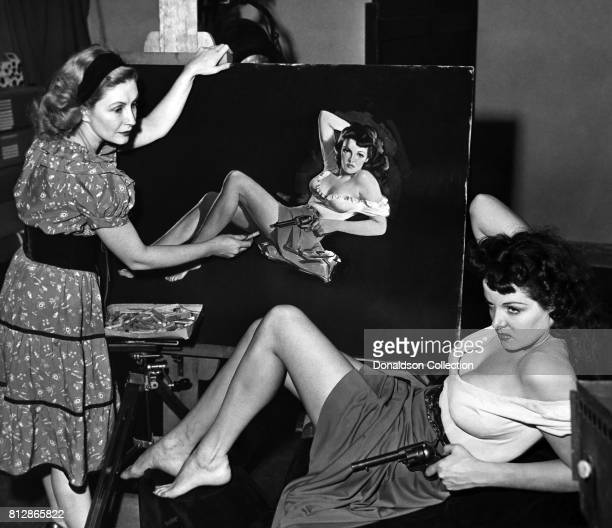 """Actress Jane Russell posses for a painting of a portrait session for the movie """"The Outlaw"""" which was released on February 5, 1943."""