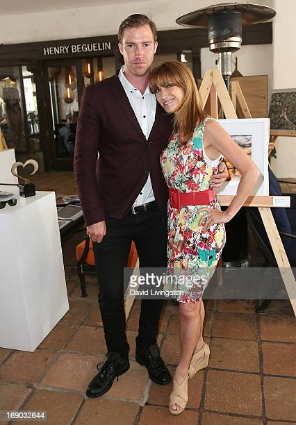 Actress Jane Seymour and son Sean Flynn attend the Malibu Fine Art Show presented by MKL Pop Gallery at the Malibu Country Mart on May 18 2013 in...