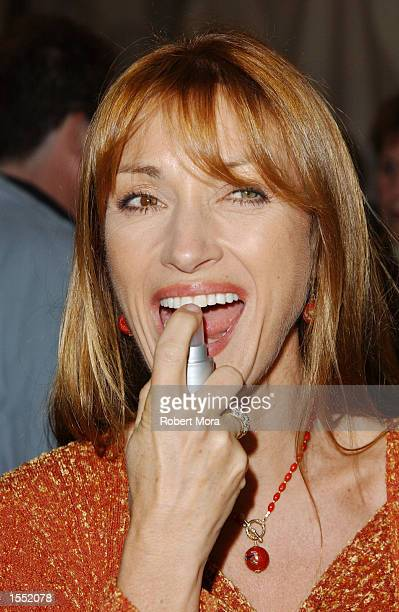 Actress Jane Seymour enjoys a sample of a new Halloween spray candy at the Hollywood Halloween Launch Party on Hollywood Boulevard on October 30 2002...