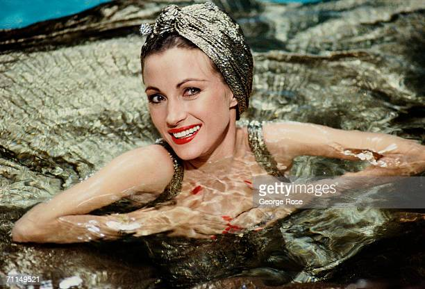 Actress Jane Seymour poses while swimming in the Queeen Mary's pool during a 1986 portrait session in Long Beach, California. Seymour was on location...