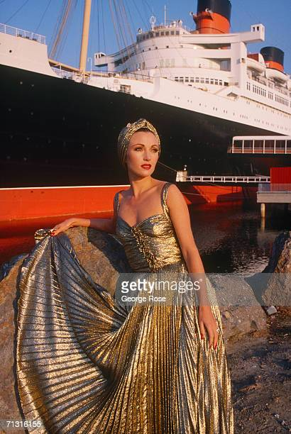 Actress Jane Seymour takes a break in front of the luxuryliner Queeen Mary during filming of the 1986 TV miniseries Crossings in Long Beach California