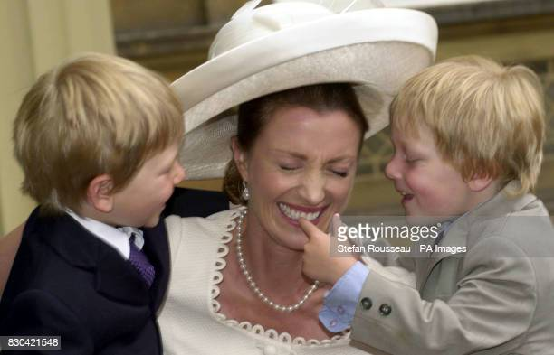 Actress Jane Seymour with her sons Chris and Johnnie at Buckingham Palace in London where she received an OBE from Queen Elizabeth II