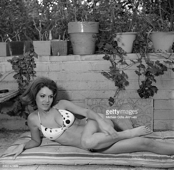 Actress Jane Wald poses in her bathing suit at home in Los AngelesCA