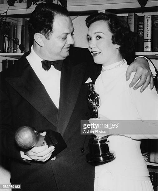Actress Jane Wyman holding her Best Actress Oscar for the film 'Johnny Belinda' and producer Jerry Wald holding his Irving G Thalberg Memorial Award...