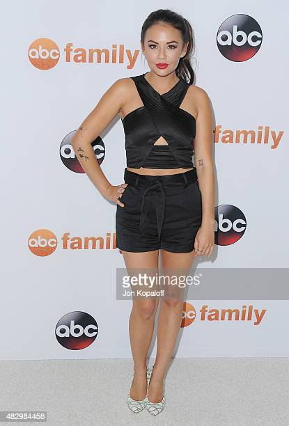 Actress Janel Parrish arrives at Disney ABC Television Group's 2015 TCA Summer Press Tour at the Beverly Hilton Hotel on August 4, 2015 in Beverly...