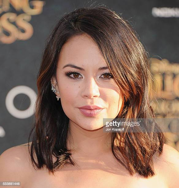 """Actress Janel Parrish arrives at the Los Angeles Premiere """"Alice Through The Looking Glass"""" at the El Capitan Theatre on May 23, 2016 in Hollywood,..."""