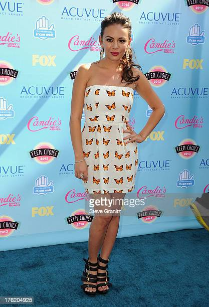 Actress Janel Parrish attends the 2013 Teen Choice Awards at Gibson Amphitheatre on August 11, 2013 in Universal City, California.