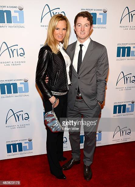 Actress Janet JonesGretzky and her son Ty Gretzky arrive at the 13th annual Michael Jordan Celebrity Invitational gala at the ARIA Resort Casino at...