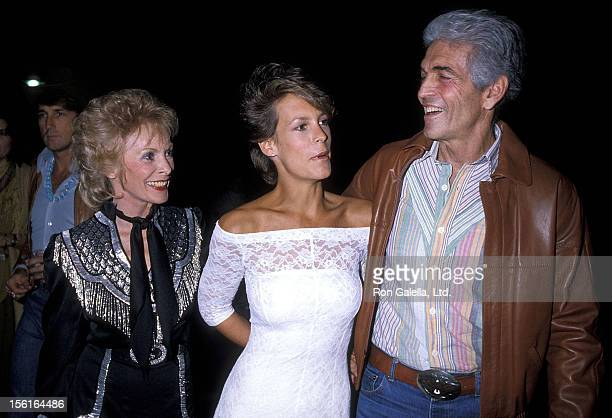 Actress Janet Leigh husband Robert Brandt and actress Jamie Lee Curtis attend the 31st Annual SHARE Boomtown Party on April 28 1984 at UCLA's Pauley...