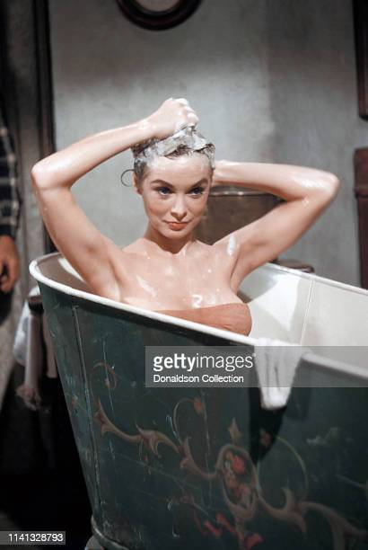 Actress Janet Leigh poses for a portrait in a bath tub in 1960 in Los Angeles, California.