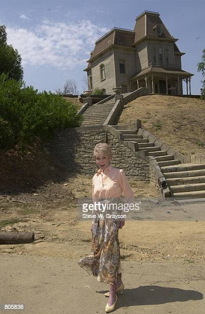 Actress Janet Leigh stands in front of the Psycho House after recreating the famous shower scene from the film Psycho August 1 2000 on the original...