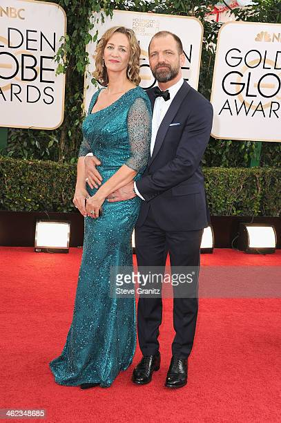 Actress Janet McTeer and Joe Coleman attend the 71st Annual Golden Globe Awards held at The Beverly Hilton Hotel on January 12 2014 in Beverly Hills...
