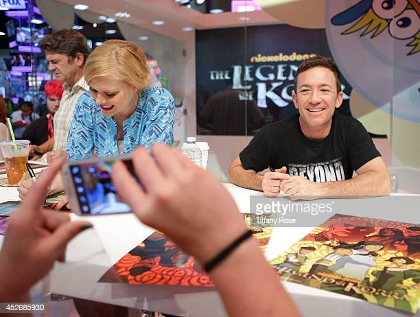 Actress Janet Varney and actor David Faustino sign autographs at the Legend of Korra signing at the 2014 San Diego ComicCon International Day 3 on...