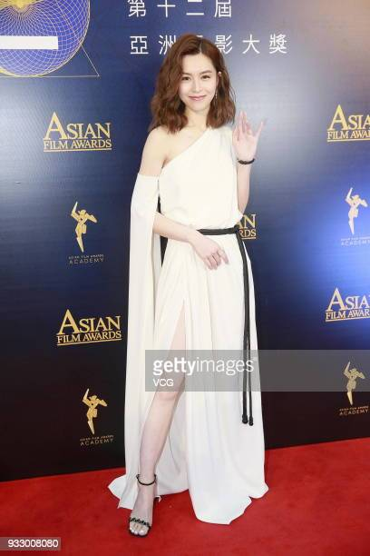 Actress Janice Man poses on the red carpet of the 12th Asian Film Awards at the Venetian Hotel on March 17, 2018 in Macao, China.