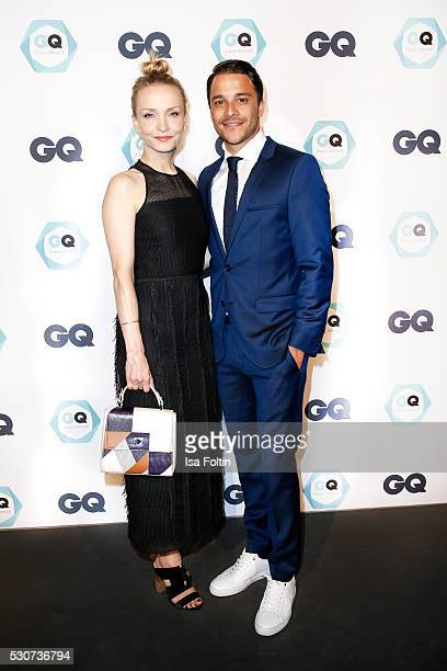 Actress Janin Ullmann and her partner actor and GQ Care award winner as best-maintained celebrity Kostja Ulmann, wearing Hugo Boss, during the GQ...