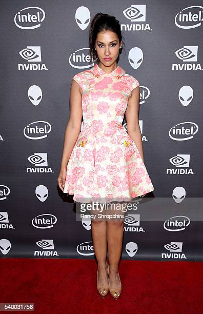 Actress Janina Gavankar checks out the latest virtual reality and gaming technology at a VIP Alienware Party during E3 in partnership with NVIDIA and...