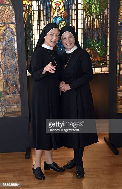 Actress Janina Hartwig and Nina Hoger during a photocall for the tv show 'Um Himmels Willen' at Literaturhaus on May 24 2016 in Munich Germany