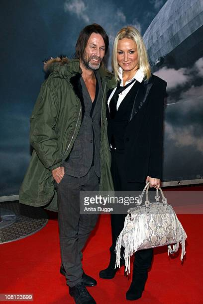Actress Janine Kunze and Dirk Budach arrive at the Kosmos movie theater for the Hindenburg premiere on January 18 2011 in Berlin Germany