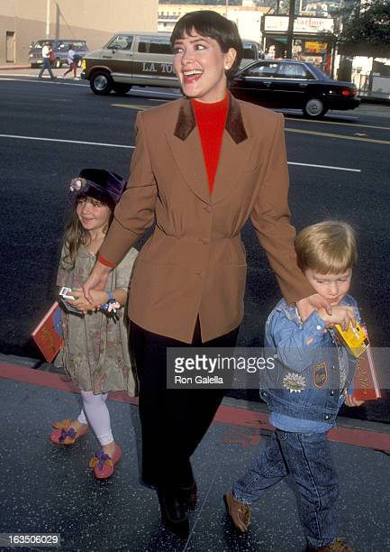 Actress Janine Turner and her niece and nephew attend the 'Aladdin' Hollywood Premiere on November 8 1992 at El Capitan Theatre in Hollywood...