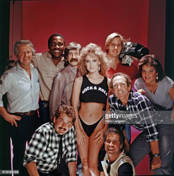 Actress Janis Farley photographer Harry Langdon and Staff pose for a portrait in 1984 in Los Angeles California